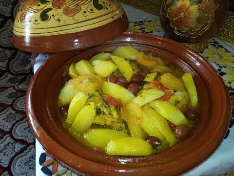 moroccan tagine with chicken, potatoes,and green olive